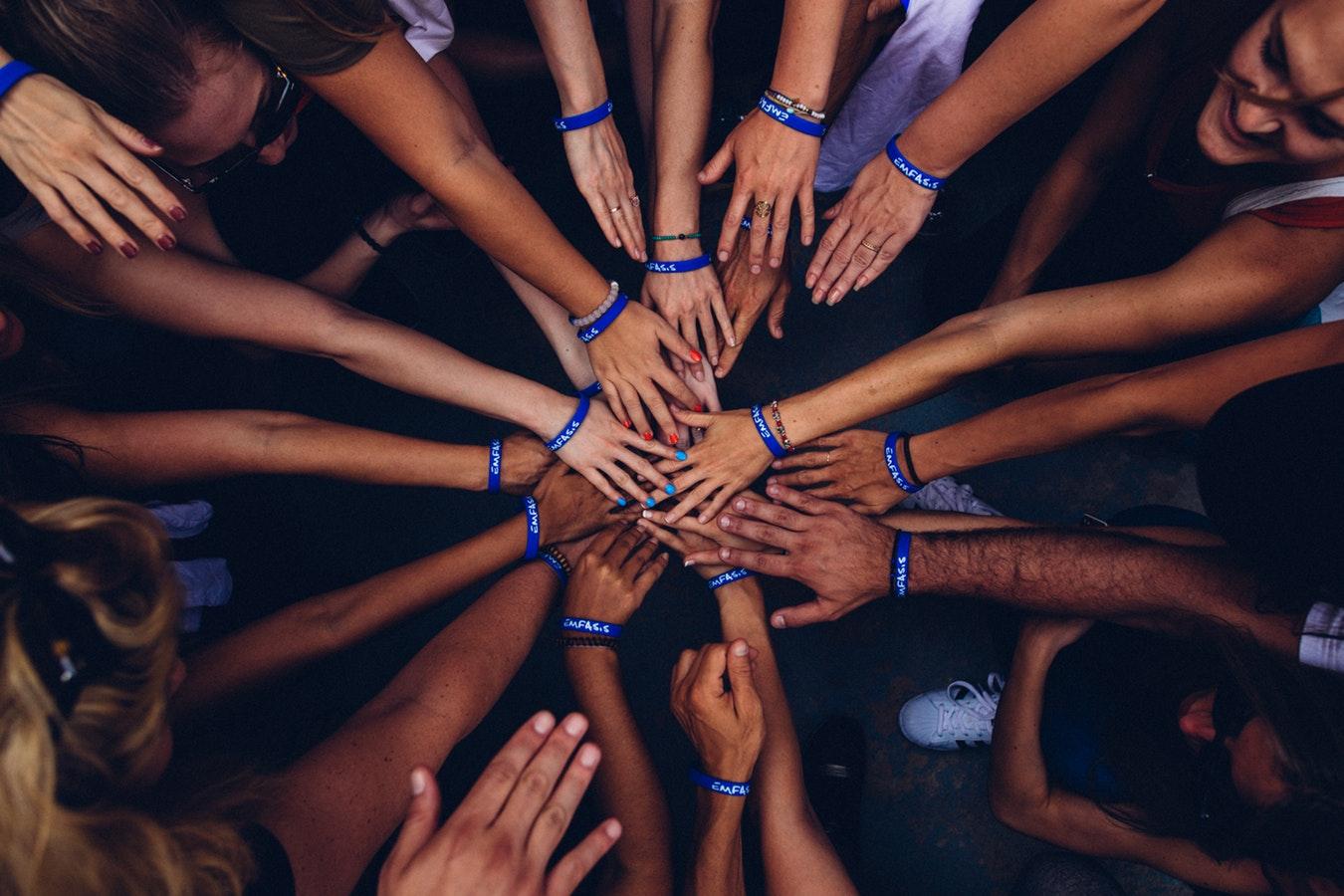 teamwork hands in a circle