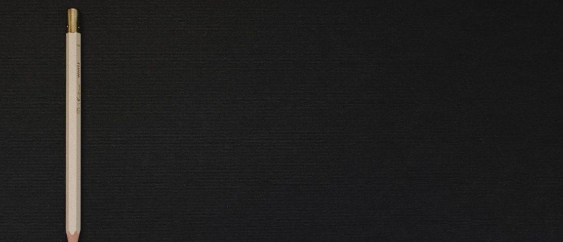 pencil on black background