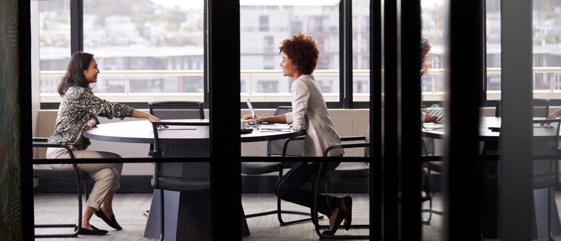 two millennial businesswomen meeting for a job interview managing interview anxiety